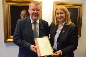 Chryssy Potsiou presents certificate to Henning Elmstroem