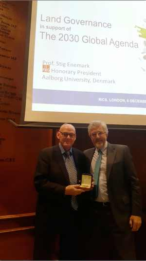 FIG Honorary President Stig Enemark receives 2016 Michael Barrett Silver Medal